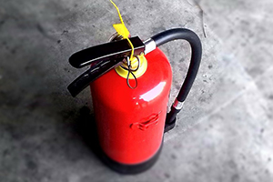 A photo of a red fire extinguisher