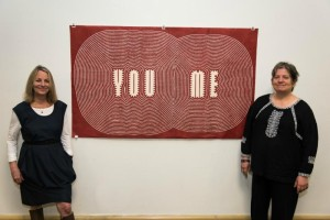 Paula Scher, left, partner in the New York office of Pentagram and Erika Greenberg-Schneider with an original woodcut