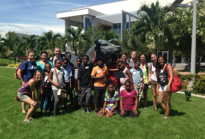 USF St. Petersburg education minors and students from Campbell Park Elementary School pose for a photograph after a tour of the university's waterfront campus.