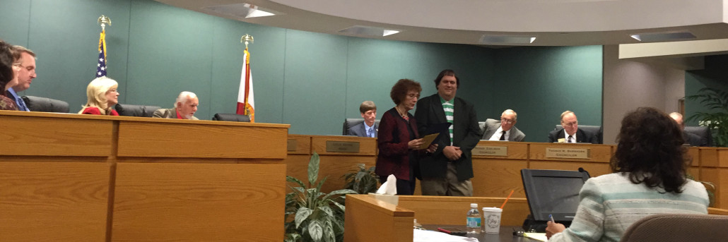 A photo of Seminole Mayor Leslie Waters presenting a proclamation to Jim Schnur, USFSP librarian of Special Collections and University Archives., during the January city council meeting.