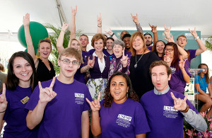 A photo of USFSP Kate Tiedemann College of Business students surround USF System President Judy Genshaft, Lynn Pippenger, and Regional Chancellor Sophia Wisniewska.