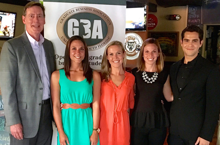 From left: Gary Patterson, interim dean, Kate Tiedemann College of Business; Megan Krieger, president, USF Tampa GBA; Lauren Thomas, director of operations, USF Tampa GBA; Erica Hausman; and Marcos Holanda, president, USFSP GBA.
