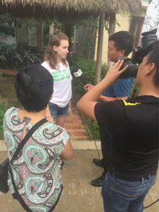 A photo of Amada Fernandez being interviewed by the Vietnamese media