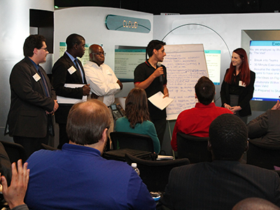 Members of the Creative Warriors team during an exercise during the Exploratory Labs Boot Camp. From left: Alexander Checca, SPC ; Michael Onagoruwa, USFSP; Ade Aderibigbe, Nova Southeastern University/Florida State University; Arpit Saluja, USF; and Meredith Cook, USFSP. Photo by Pat Gehant.