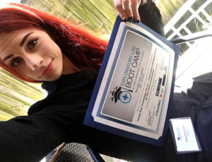 A photo of USFSP student Meredith Cook holding a Exploratory Labs Boot Camp certificate