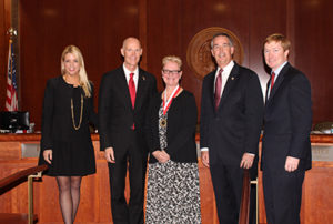 A photo of Florida Attorney General Pam Bondi, Gov. Rick Scott, USFSP alumna Janet Acerra, Chief Financial Officer Jeff Atwater, and Commissioner Adam Putnam.