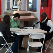 A photo of USFSP journalism students conducting an interview with a Midtown resident.