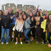 A photo of USFSP students and Dr. Dan Marlin at Stonehenge in England.