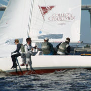 A photo of Mandi Dickie, Brendan Feeney, Scott Ewing, and Sean Cornell sailing in the competition in Charleston, S.C. Photo credit: Alan Capellin.
