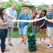 A photo of USFSP students cutting a ribbon at the ceremony for the new Bayboro Food Forest