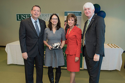 A photo of Dr. Kathryn Arthur accepting an award from the USF System. Photo credit: Ryan Noone