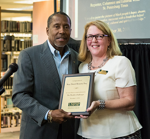 Rep. Darryl Rouson and Cathi Cardwell, dean of the Nelson Poynter Memorial Library