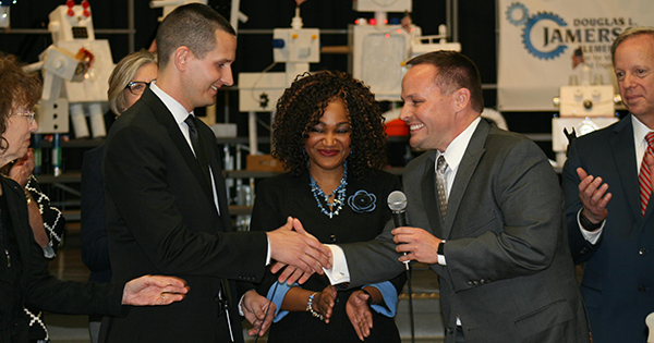 From left: Milken Family Foundation Senior Vice President Jane Foley, USFSP alumnus and award recipient Lukas Hefty, Jamerson Principal Brandie Williams-Macon, Florida Department of Education Deputy Chancellor of Education Quality Brian Dassler, and Pinellas County Schools Superintendent Michael Grego. Photo: WUSF and Cathy Carter