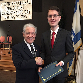 A photo of USFSP student Eric Durneika receiving an award from Vincent Genovese, the consular correspondent of Italy for Tampa Bay