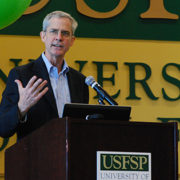 A photo of Thomas Smith, associate professor of Political Science and director of the USFSP Honors Program, speaking to students and their families at the Honors Brunch.