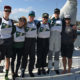 A photo of six USFSP students in Charleston, SC, at a sailing regatta