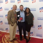 A photo of Harris Ambush with two people standing next to him on the red carpet. Photo credit: Harris Ambush.