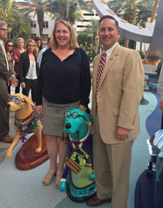 A photo of Cathy Cardwell and Rick Kriseman standing on either side of the