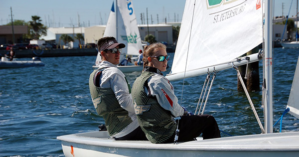 A photo of two student sailors during the Frank I. Mendelblatt Regatta at USFSP.