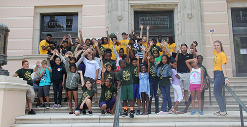 "Elementary students in the ""PREP for Middle School Success"" program along with USFSP education majors take a field trip to St. Petersburg City Hall."