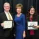 Left to right: USF President Judy Genshaft (center) presents Global Achievement Awards to Interim Regional Chancellor Martin Tadlock and Director of Global Initiatives Wendy Baker.