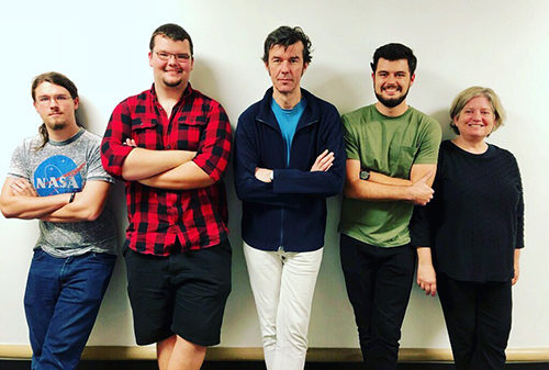 Stefan Sagmeister (center) worked with USFSP Professor and internationally distinguished Master Printer Erika Greenberg Schneider (far right) and her undergraduate students on a print and answered questions on design school and skills needed to advance in the design world.