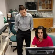 USFSP Neighborhood News Bureau director Bernardo Motta (left) and College of Marine Science research associate Dr. Kelly Quinn look over findings of tests for lead in the water from homes of Academy Prep students in St. Pete's Midtown neighborhood. Photo by Mark Schreiner; WUSF News.
