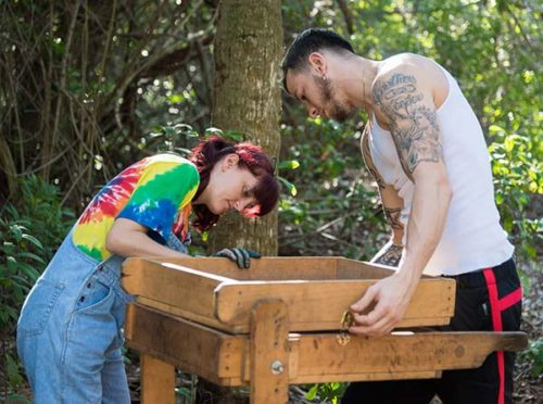 Shana Boyer and Andrew Haines adjusting a screen at the Weedon Island Archaeological site.