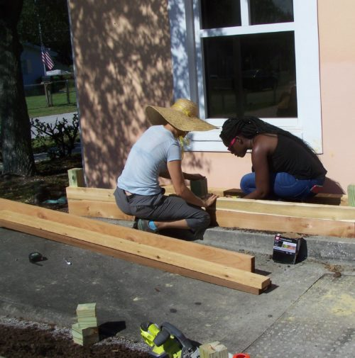 Malory Foster, IFAS staff member, and Cortney Roquemore, USFSP student, work on a Garden Build Project at the Lealman Asian Neighborhood Family Center.