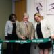 From left to right: Interim Regional Vice Chancellor of Academic Affairs Olufunke Fontenot, Interim Regional Chancellor Martin Tadlock and Dean of the Nelson Poynter Memorial Library Catherine Cardwell unveil a newly revamped Special Collections Reading Room at USF St. Petersburg.