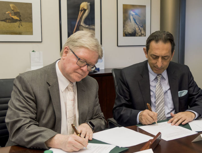 Interim Regional Chancellor Martin Tadlock (left) and Professor Blerim Reka from South East European University sign the collaboration agreement.