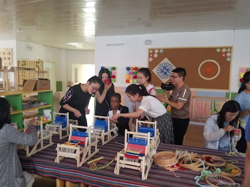 Dr. Moore participating in an activity with her students in China.