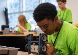 A student programs a robot during the STEM robotics camp at the USFSP College of Education.