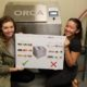 Members of the Student Green Energy Fund pose in front of the newly installed ORCA.