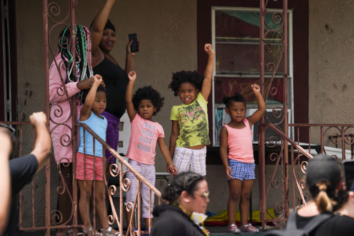 Ascenio-Rhine's favorite image that she captured so far is this one of a group of young girls raising their fists in support as hundreds of people participate in a march by their home. Photo by Martha Asencio-Rhine, Tampa Bay Times.