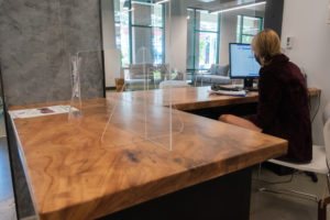 The reception desk in Osprey Suites is made from salvaged wood.