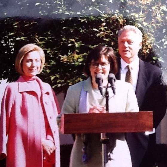Professor Judithanne Scourfield McLauchlan with President Bill Clinton and Hilary Clinton in the rose garden.